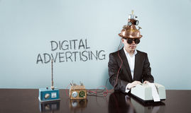 Digital advertising concept with vintage businessman and calculator. At office Royalty Free Stock Images
