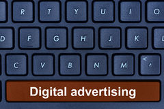 Digital advertising words on computer keyboard button stock photos