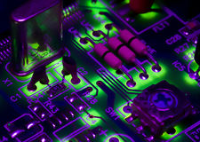 Digital age. High-tec digital electronics, strong colours and backlit royalty free stock photo