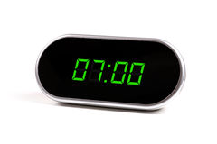 Digital alarm clock with green digits Royalty Free Stock Photo