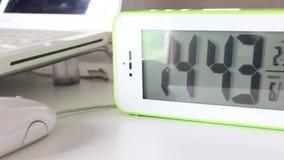 Digital Alarm Clock On The Table. Digital Alarm Clock On The Table In Workplace stock video