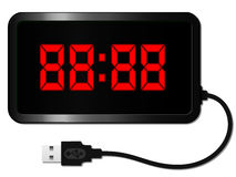 Digital alarm clock with USB cable Royalty Free Stock Images
