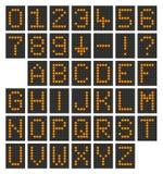 Digital alphabet & numbers. Orange digital numbers and alphabet on dark background Royalty Free Stock Image