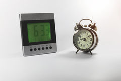 Digital and analog alarm clock. On white background Royalty Free Stock Images