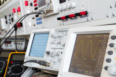 Digital and analog oscilloscope in the foreground Stock Images