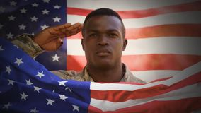 Digital animation of American soldier saluting against swaying American flag. American flag on foreground 4k stock video footage