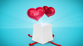 Digital animation of birthday gift exploding and revealing heart. On blue backgound stock video