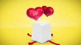 Digital animation of birthday gift exploding and revealing heart. On yellow background stock video