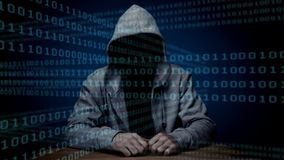 Digital animation of hacker sitting on table. Binary code technology on blue background 4K stock footage