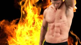 Naked man with athletic body. Digital animation of a naked Caucasian man with athletic body with left arm up while background shows burning fire stock video footage