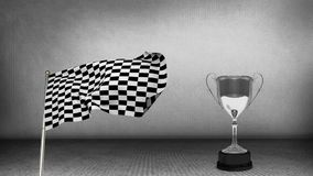 Racing flag beside a trophy