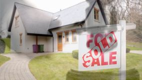 Digital animation of sold home for sale real estate sign and beautiful new house. Gavel banging on sounding block 4k stock video