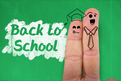 Composite image of digital anthropomorphic smiley faces of students on fingers. Digital anthropomorphic smiley faces of students on fingers against blackboard Stock Photos