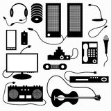 Digital appliances and musical symbols Stock Photography