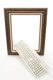 Digital Art. Wood Picture Frame and computer keyboard, concept of digital art produce Royalty Free Stock Photo