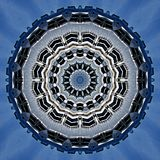 Silvery metal objects  seen through kaleidoscope. Digital art design. Abstract silvery  texture of metal against blue sky  seen through a kaleidoscope Stock Photo