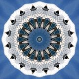 Silvery metal objects  seen through kaleidoscope. Digital art design. Abstract silvery  texture of metal against blue sky  seen through a kaleidoscope Royalty Free Stock Photography