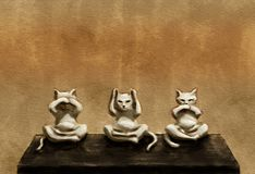 Three wise cats. Digital art. `Three wise cats` - analogy to the `Three wise monkeys`. Canvas texture Stock Photos