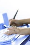 Digital artist at work. Digital artist working at workstation stock image