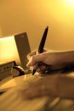 Digital Artist working. At workstation stock image
