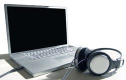 Digital Audio. Laptop and Headphones Royalty Free Stock Image