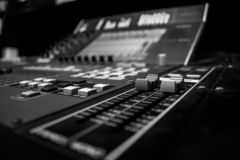 Professional Audio Mixing Console with digital control encoder. Wide angle shot of Professional Audio Mixing Console with digital control encoder, monochrome royalty free stock photography