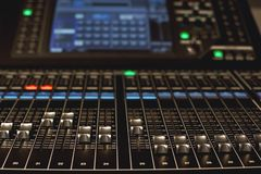 Digital Audio mixing console. Close-up view of professional equipment for sound mixing. Focus on audio control buttons. Digital Audio mixing console. Close-up royalty free stock photo
