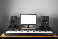 Digital audio workstation studio with electronic piano and monitor speakers Royalty Free Stock Photography