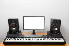 Digital audio workstation studio with electronic piano and monitor speakers Stock Photography