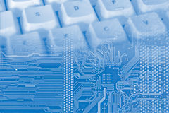 Digital background. Blue background with electronic circuit and keyboard Stock Photo