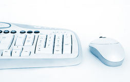 Digital background. Keyboard and mouse on blue isolated on white background Stock Images