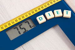 Digital bathroom scale with tape measure, slimming concept Stock Images