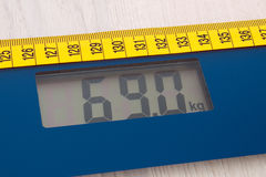 Digital bathroom scale with tape measure, slimming concept Stock Photos