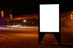 Digital billboard with clear copy space screen background for your text message or information content, electronic banner in night. Empty poster in urban setting Royalty Free Stock Photo
