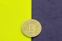 Digital bitcoin on a acid on a purple background. stock photo