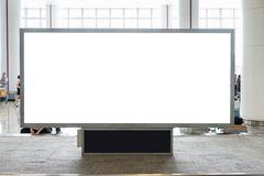 Digital blank billboard with copy space for advertising, public. Information in airport hall blurred background stock image