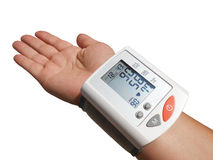 Digital blood preasure monitor, palm is open Royalty Free Stock Photos