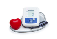 Digital blood pressure meter with love heart symbol on white background Royalty Free Stock Image