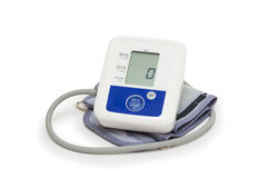 Digital blood pressure meter with love heart symbol on white background Stock Image