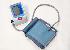 Digital blood pressure meter with red start button. stock image