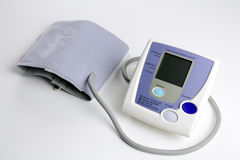 Digital Blood Pressure Monitor. At home digital blood pressure monitor on white background Stock Photo