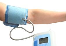 Digital blood pressure monitor. Blood pressure measurement. A white background Stock Photos