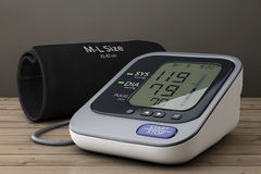 Digital Blood Pressure Monitor with Cuff. 3d Rendering Stock Images