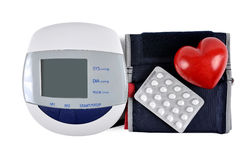 Digital blood pressure monitor with heart and pills Royalty Free Stock Photo