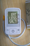 Digital blood pressure monitor with message Royalty Free Stock Images