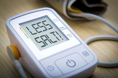 Digital blood pressure monitor with message Stock Photo