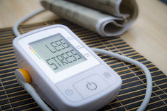 Digital blood pressure monitor with message Stock Photos
