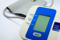 Digital Blood Pressure Monitor on white Royalty Free Stock Images