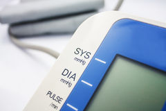 Digital Blood Pressure Monitor on white Royalty Free Stock Photos