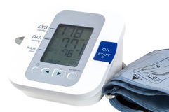 Digital blood pressure monitor on white background Royalty Free Stock Photos
